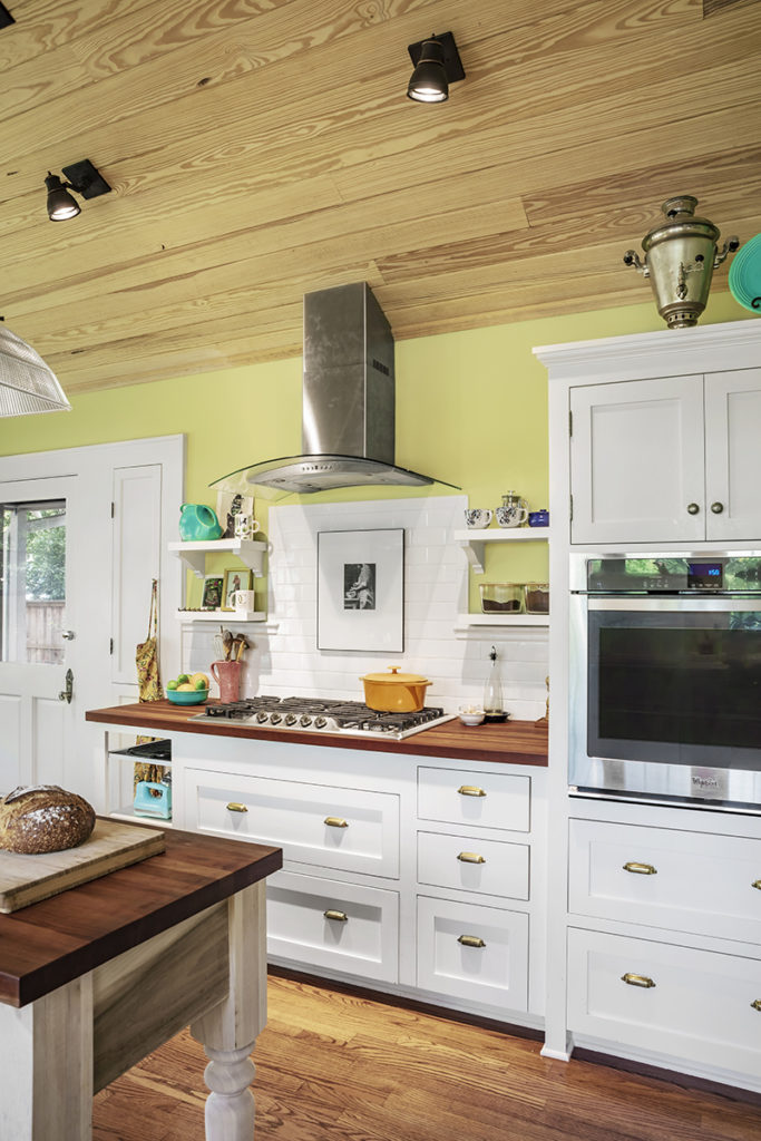 New kitchen addition with stone, butcher block countertop, built in oven and solid wood floors.