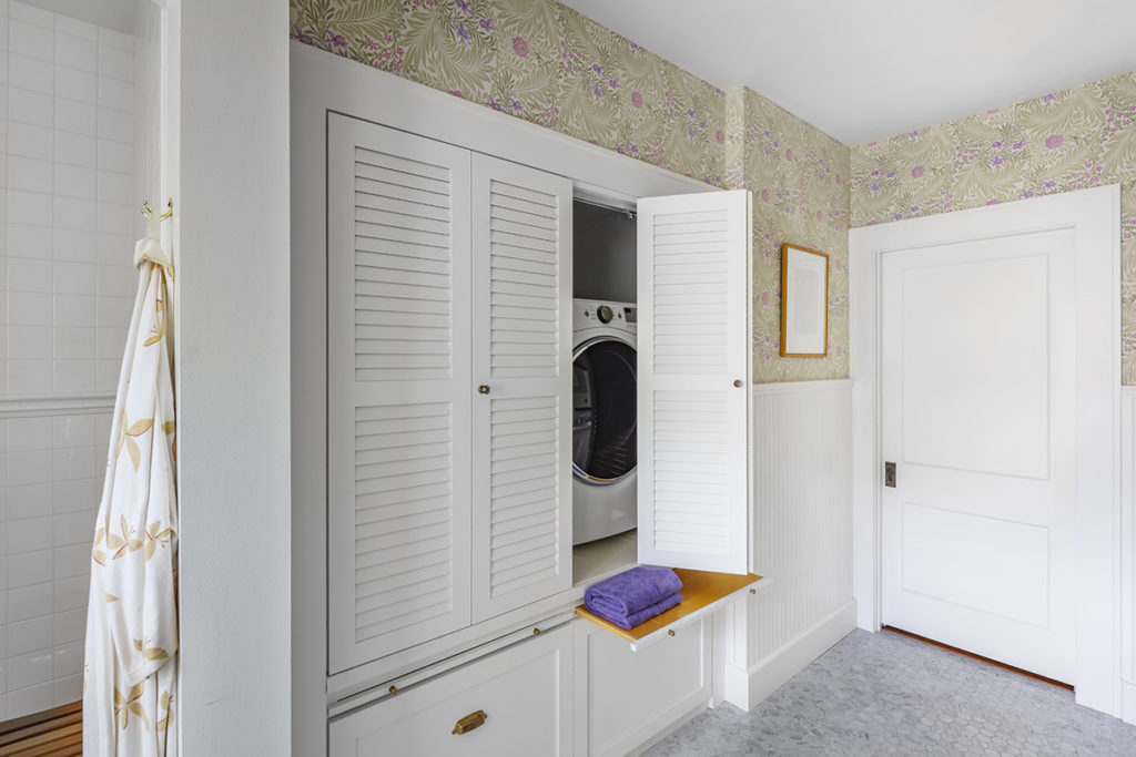 New laundry storage hidden in Master Bathroom